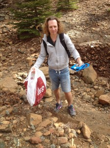 with a bagful of picked litter