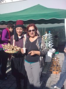 our walk leader at a reenactment of 1900 period, with street vendor Gerard