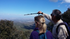 Walk leader identifying a location at a viewpoint